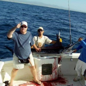 """marlin when the Marlin got up to the boat, Freddie gaffed it and the Capt ran back and gave it a second gaff and then Freddie started beating it with the bat so I turned to my buddy on the camera and said """" I guess we're keeping it!"""" The Capt and crew was"""